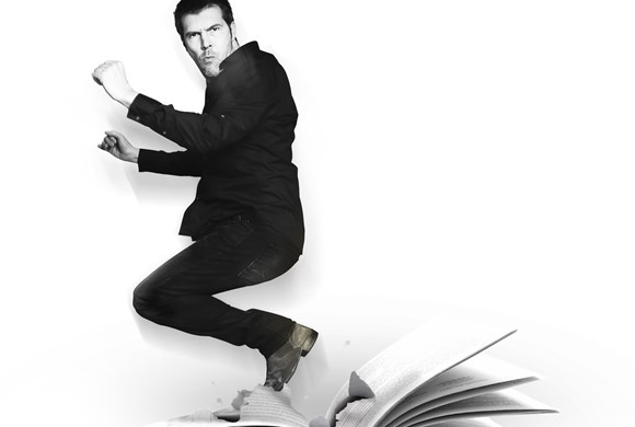 Rhod Gilbert jumping off book
