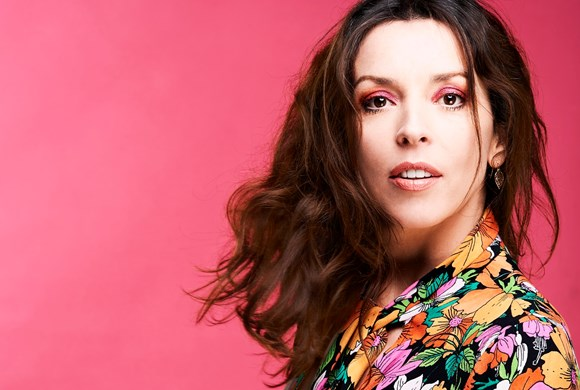 Bridget Christie with pink background photo