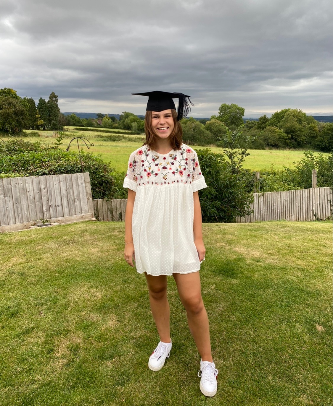 Florence Roxburgh outside with graduate cap